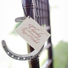 horseshoe wedding favors with a card explaining the tradition of good luck that comes from hanging a horseshoe above the door :)