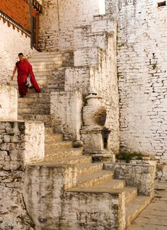 Bhutan: Kingdom to Happiness. Monk descending monestery stairs In Bhutan Tibet, Amazing Places On Earth, Vietnam, Destinations, Stairway To Heaven, Small World, Stairways, Nepal, Places To See