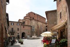 Panicale, Umbria, Italy -- oh, to be sipping my Campari & Soda in one of those red chairs again!