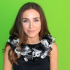 "Handmade Scarf from "" Vlora Shileku"". A knitted scarf in a very unique design. It is a cirkle shaped skarf coloured in black, white and grey with shiny material in the inner side.This beautiful knitted scarf is perfect for the changing weather, and will be fun to wear all season long. Material : This scarf is made from Lladerian, Cowel."