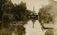 The steamboat Black Prince on Bayou Teche near St. Martinville; note the person and primitive ferry at right.  Source: Postcard image, Shane K. Bernard Collection