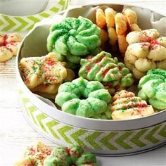Cream Cheese Spritz Recipe -A hint of orange and cinnamon highlights these Christmastime classics. I like to add colorful sprinkles before baking them. The recipe is from a booklet that came with a cookie press in the 1950s...and I still have the press! —Sarah Bedia, Lake Jackson, Texas