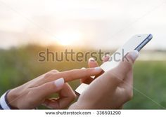 hand using phone outdoor at sunset