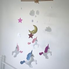 My ever popular unicorn mobile in pinks and lilacs. Each and every item is handmade by yours truly and I ensure the closest attention to detail. I love this one.