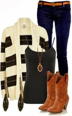 White and black cardigan, dark blue pants, black blouse and long brown boots