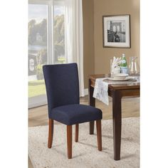With their elegant fabric upholstery and warm mid-tone wooden legs, these padded dining room chairs upgrade the look of any room. The set of two chairs is designed with inner padding which provide a comfortable seating experience.