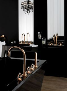 mysterious black bathrooms - with golden details