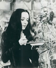 I was convinced this family was where I really belonged growing up. I love this woman. Morticia