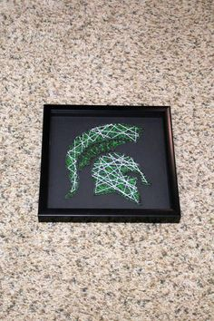 Officially licensed msu spartan string art by crazycraftingmaze michigan state spartan helmet nail string art by mittensisters freerunsca Images