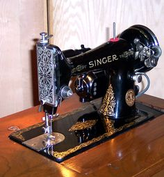 This Singer 99 is a 3/4 size version of the famous Singer 66.  That's the one that had all the beautiful decal patterns, like the Red Eye, the Lotus, etc.  It's a good reliable machine, capable of some serious sewing.  I've sewn 8-layers of denim on this machine, as well as canvas and leather.  My friend put a hand-crank on hers and sewed a full-size teepee with it.  Sorry to say this one's already sold.