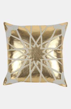 Pretty gold accent pillow.