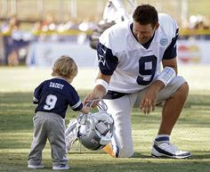 Cowboys QB Tony Romo and his son Hawkins. SO cute.