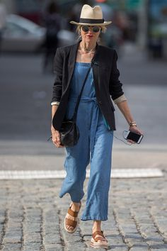 23 May Naomi Watts was also spotted wearing denim. She chose a baggy jumpsuit with a black tailored blazer and espadrille sandals. - HarpersBAZAAR.co.uk