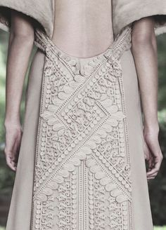 Dress back detail with ornate textural patterns like carved clay - surface embellishment; artful fashion details // Givenchy Haute Couture