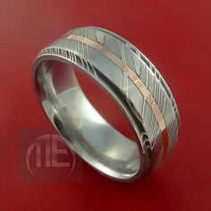 men's wedding ring - different, but probably not modern enough for him