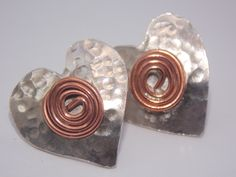 handmade solid sterling silver and copper heart earrings.x