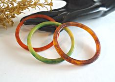 3 Vintage Bakelite Bracelets Bangles Green Orange Apple Juice by TreasureCoveAlly on Etsy