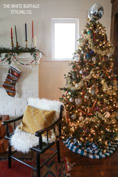Boho and eclectic Christmas with a disco ball tree topper and a woven throw as a tree skirt #boho #christmas