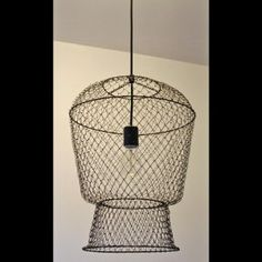 Industrial basket lighting fixture~ I have one of these fish baskets in shed