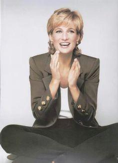 Princess Diana looks happy.
