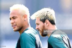 Neymar Jr. (L) and Lionel Messi of FC Barcelona look on during a training session ahead of their UEFA Champions League Group C match against Celtic FC at Ciutat Esportiva of Sant Joan Despi on September 12, 2016 in Barcelona, Spain.