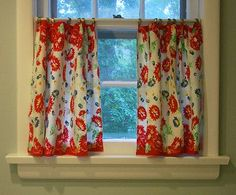 Tea towel cafe curtains. Thrift store finds tend to have more character than their generic box store relatives.