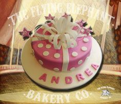 Cute pink cake, decorated with fondant and gum paste