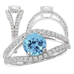 18k Elite Collection cultured 6.5mm round Aquamarine Spinel engagement ring with continuous split shank