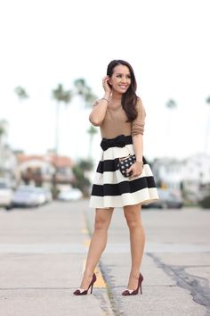 Simple and Chic Outfit: Black and white striped skirt, bow belt, bow topped jacquard polka dot clutch and bow heels - StylishPetite.com
