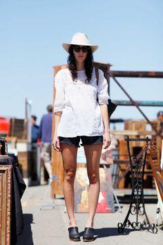 Denim Street Style: Nikki wears a classic white eyelet blouse and black denim cut-offs