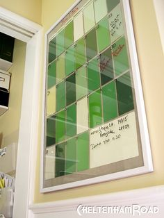 Paint chips behind framed glass = instant dry erase calendar. Clever!