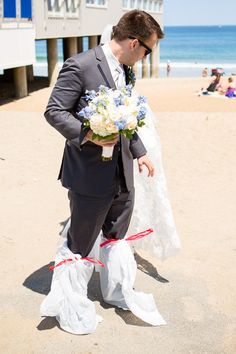 Bring flip flops or wrap the groom's feet in garbage bags for a beach shoot to keep sand from getting into the tux shoes. Take off the bags for photos when standing on harder pack sand. Young Love at its Best — Chris and Elizabeth's Dream Wedding