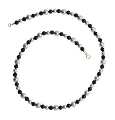 The Black Onyx and Grey Pearls Silver Necklace is a classic design in Black and Grey from the Inspired Essentials Collection by Lee Buchanan Jewelry. You'll wear this season-spanning designer necklace with many outfits!  The traditional silver necklace offers stylish simplicity with alternating Black Onyx Beads and two sizes of Swarovski Grey Pearls. A perfect necklace to make your own fashion statement!