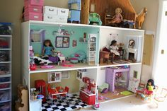 """pippaloo for dolls: The Dollhouse Tour: constructed from four boxes each measuring: 24""""D x 48""""L x 28"""" H,  And a bonus attic space on the third floor for Kit and her things."""