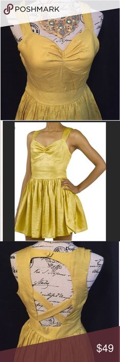 Anthropologie The Addison Story Yellow Mini Dress What an adorable dress! Brand is called The Addison Story (sold at Anthropologie stores). It is size small. The color is yellow/gold. Made of 35% nylon, 65% cotton. Zips up the side. Cross-cross back with a button at top. Anthropologie Dresses