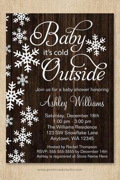 Baby it's cold outside baby shower invitations. A rustic winter theme featuring white snowflakes and modern script font on a wood background. This gender neutral design is perfect for a boy or girl baby shower.