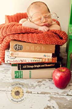 Baby bookworm photo shoot.  So many books and a lifetime to read them!