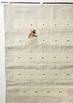advent calendar - so charming, wonderful simple fabric and lettering. Replace the teddy bear with something else?