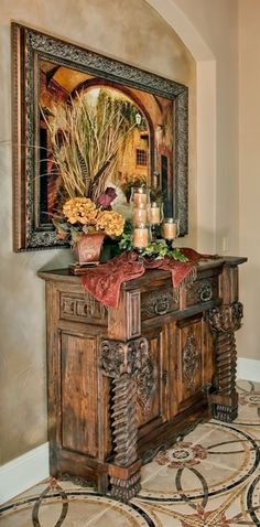 vignette... Love the floor, credenza, and wall finish in the niche.