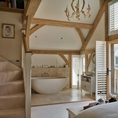Country bathroom barn conversion. Open plan bedroom and bathroom increases light, good use of space.