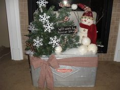 Arrangement in a vintage ice chest.  Can't see the mica sparkles on the trees and snowballs.