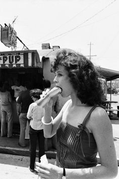 Sigourney Weaver eating a hotdog in Los Angeles, 1983