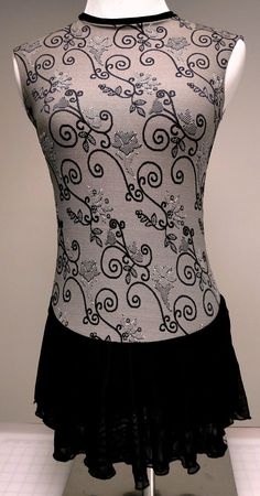 Want to stand out during practice ice before a competition? This figure skating dress is made of of a unique heavy weight jacquard print, double