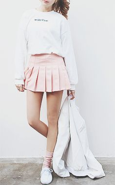 White graphic sweaters, ponytails, pastel skirts, and comfy sneakers. Casual, yet girly at the same time.