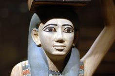 Tomb of Meketre, western Thebes  Wooden statue of a servant carrying a fowl and balancing a basket on her head. She is finely carved and painted and is one of the finest examples of this type.