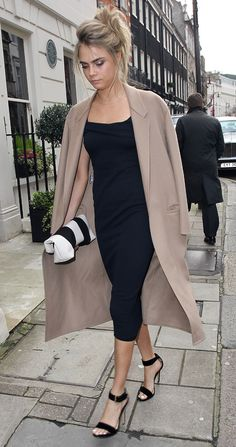 cara delevingne at sister chloe wedding lunch - navy dress and cream coat - what to wear to a wedding - handbag.com