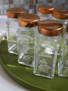 reserved for ycneedle six griffiths spice jars glass with copper colored lids
