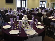 Wedding Centerpieces. Purple and green with lace and lanterns. Table design.