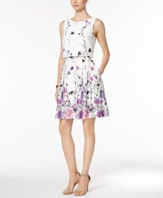 A sweet floral-print design paired with a unique popover silhouette create the perfect combination in this Ivanka Trump day dress. | Shell and lining: polyester | Dry clean | Imported | Concealed back