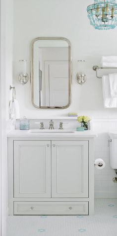 Bathroom with small vanity. This bathroom features a small vanity with glass knobs, white marble countertop and shelf. The vanity comes with a built-in step stool at the bottom. It's a step for one of the kids who couldn't quite reach the sink yet. Diy Bathroom Decor, Bathroom Styling, Small Bathroom, Bathroom Designs, Bathroom Ideas, Master Bathroom, Aqua Bathroom, Bathroom Beach, Bathroom Hacks
